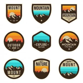 Gekleurde avontuur badges