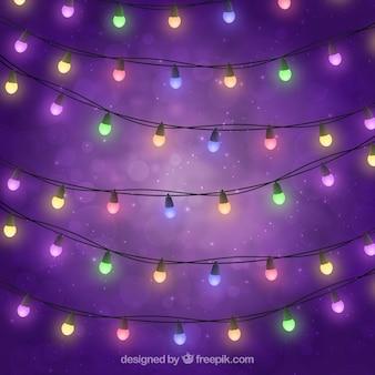 Gekleurde lichten op paarse achtergrond