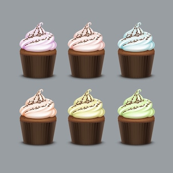 Gekleurde lichtroze blauwgroene gele cupcake