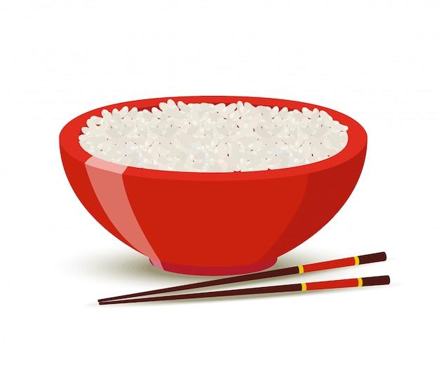 Gekookte rijst in rode kom.