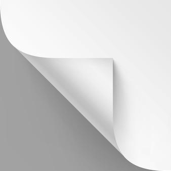 Gekrulde hoek van wit papier met schaduw
