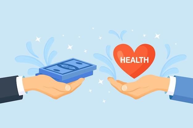Geld en rood hart in handen. ziektekostenverzekering en gezondheidszorg. onevenwicht tussen levensstijl en werk. vergelijking van zakelijke stress en gezond leven. werk leven balans