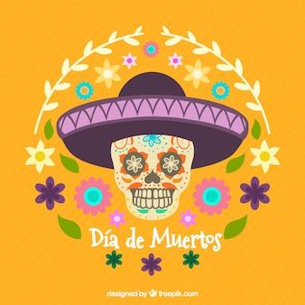 Gele achtergrond met schedel en mexicaanse hoed