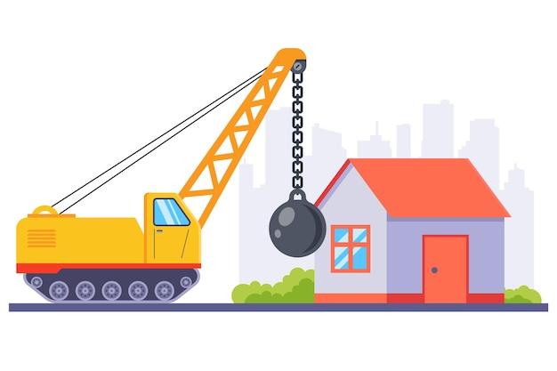 Gele bouwmachines slopen een oud huis met een grote metalen bal.