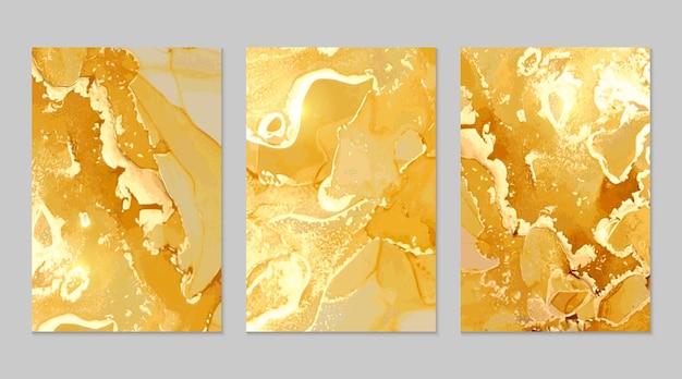 Gele en gouden marmeren abstracte texturen