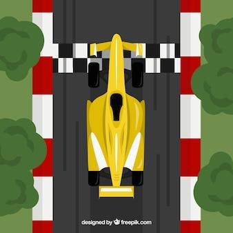 Gele f1 raceauto kruist afwerkingslijn