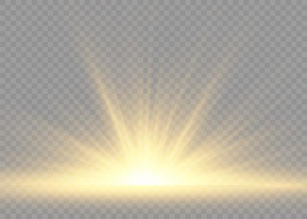 Gele gloeiende lichten zonnestralen. flits van de zon met stralen en spotlight.