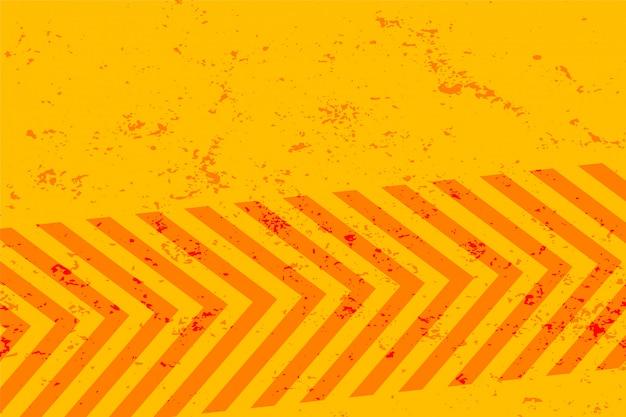 Gele grungeachtergrond met oranje strepenontwerp