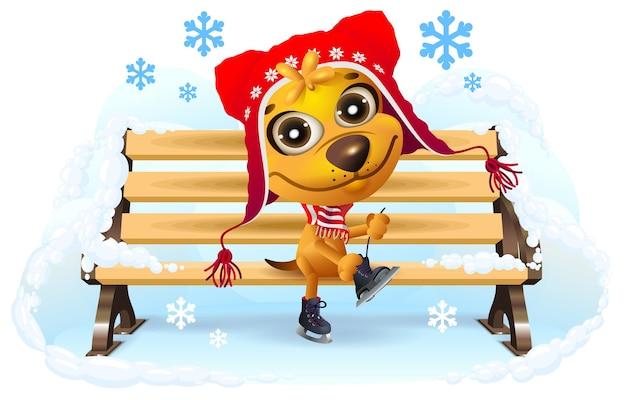 Gele hond trekt schaatsen aan. winter vakantie.