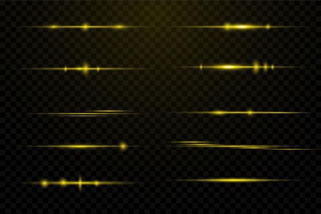 Gele horizontale lensfakkels. laserstralen, horizontale lichtstralen. mooie lichtfakkels. gloeiende strepen op een donkere achtergrond. lichtgevende abstracte sprankelende beklede achtergrond.