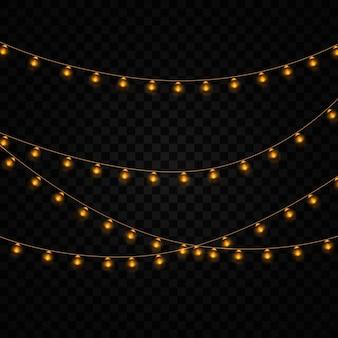 Gele lichten isoleerden realistische elementen op transparante achtergrond. set van gouden gloeiende garland. verlichting voor holiday wenskaart ontwerp. slingers, feestdecoraties.
