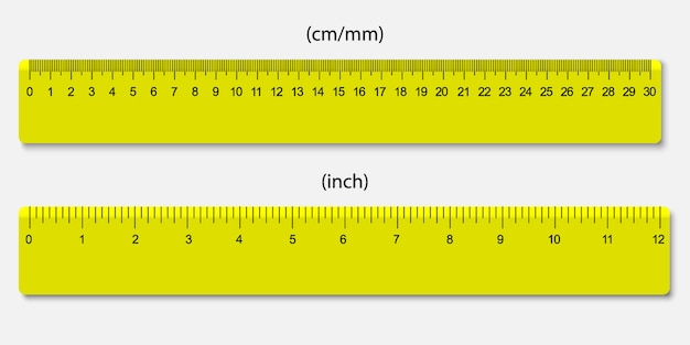 Gele linialen, gemarkeerd in centimeters en inches