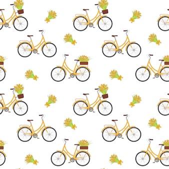 Gele retro fiets met tulpen in bloemenmand en op boomstam.