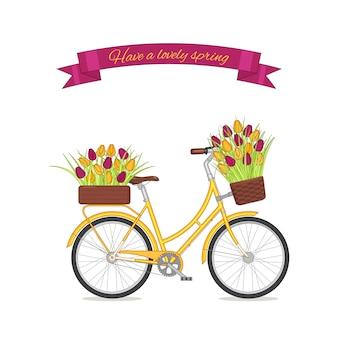 Gele retro fiets met tulpenboeket in bloemenmand en doos op boomstam.