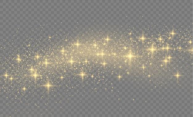 Gele stofgele vonken en gouden sterren schijnen met speciaal licht