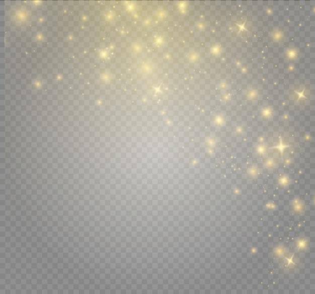 Gele vonken en sterren schijnen met speciaal licht. sprankelende magische stofdeeltjes. het effect van een overstraling met een lichtstraal en magische schittering. een komeet aan de hemel.