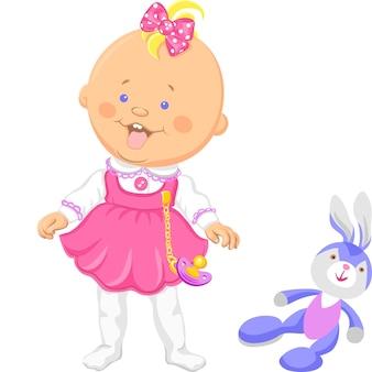Gelukkig babymeisje in een roze jurk die leert lopen