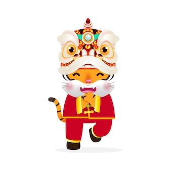 Gelukkig chinees nieuwjaar 2022 het jaar van de tijger schattige kleine tijger voert leeuwendans uit