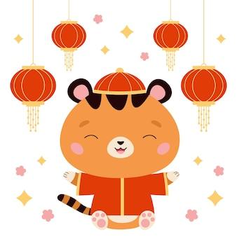Gelukkig chinees nieuwjaar symbool tijger in traditioneel rood kostuum