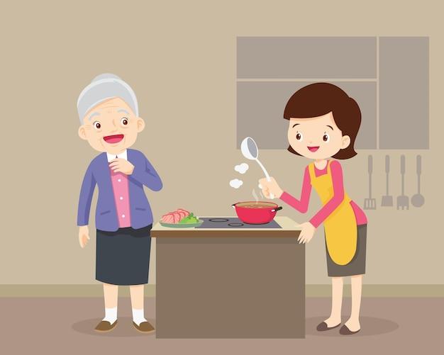 Gelukkig gezin met grootouder en moeder koken in de keuken