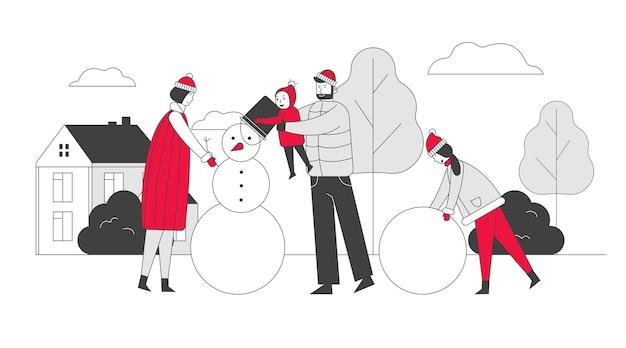 Gelukkig gezin met kinderen sneeuwpop maken met wortel in plaats van zijn neus op winterlandschap