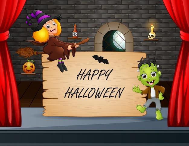 Gelukkig halloween met frankenstein en heks die op het podium presteren