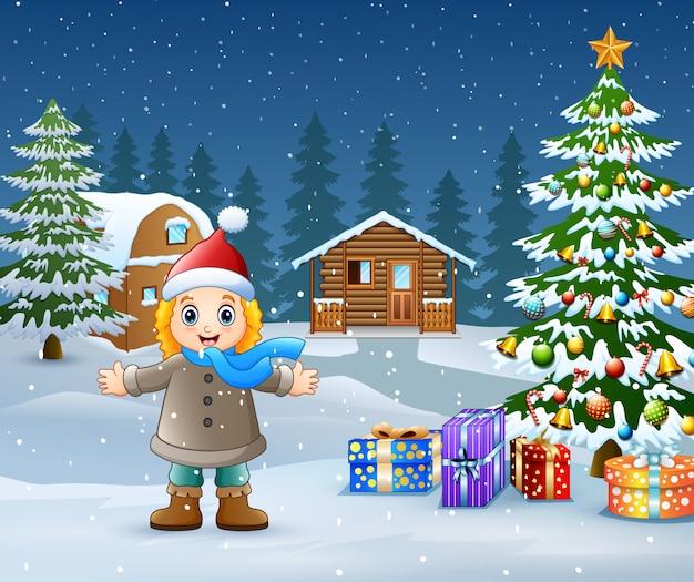 Gelukkig jong geitje die de winterkleren in kerstmisdag dragen