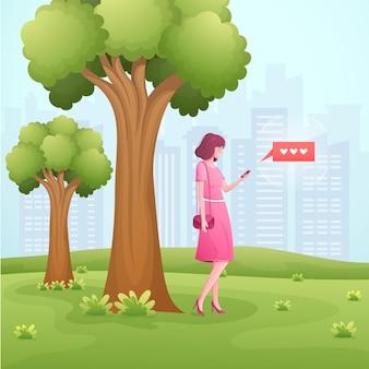 Gelukkig jonge vrouw chatten op smartphone in het park.