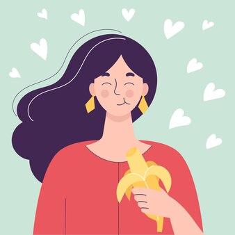 Gelukkig leuke vrouw die banaan eet