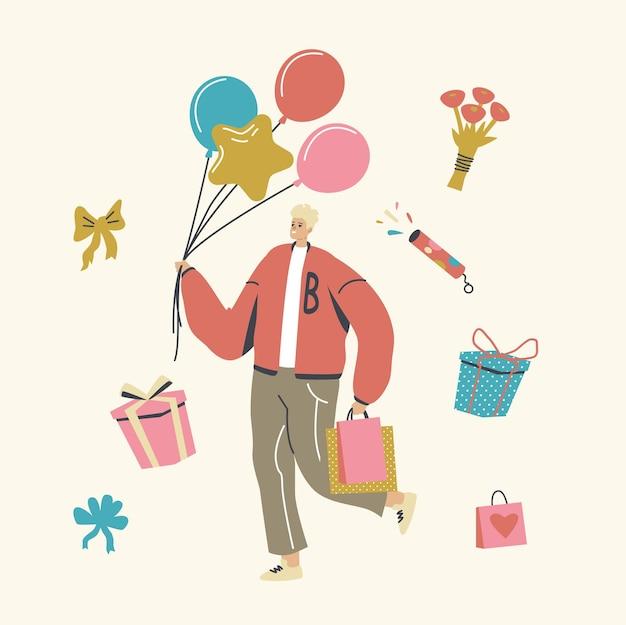 Gelukkig man dragen ballonnen en geschenken in papieren zakken of dozen verpakt met feestelijke strik
