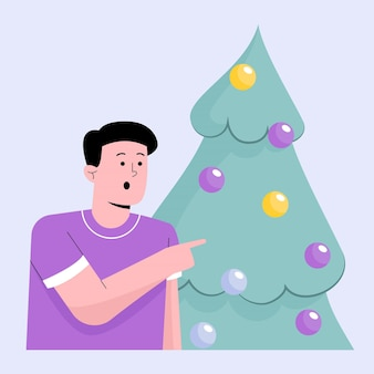 Gelukkig man met groene kerstboom