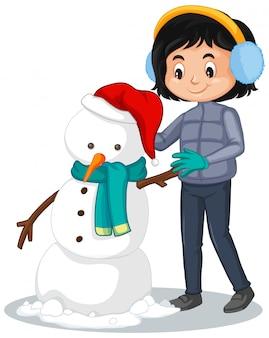 Gelukkig meisje dat sneeuwman op wit maakt