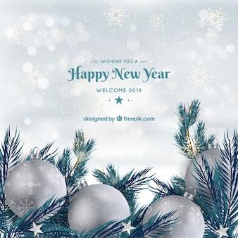 Gelukkig nieuw jaar als achtergrond met zilveren snuisterijen
