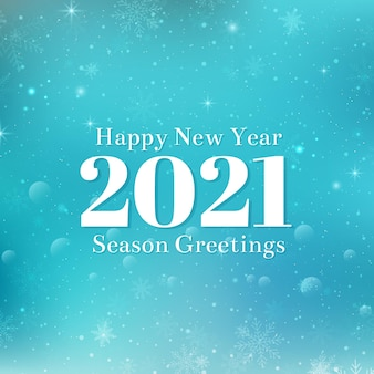 Gelukkig nieuwjaar 2021 tekstontwerp. witte cijfers en sneeuwvlokken. blauwe winter achtergrond met bokeh, lichten en sneeuwvlokken