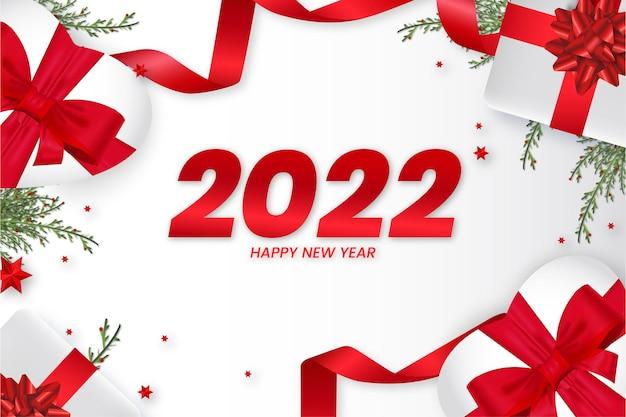 Gelukkig nieuwjaar 2022 achtergrond met realistische kerst 3d-elementen