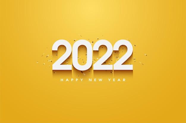 Gelukkig nieuwjaar 2022 met nummers gearceerd op een gele achtergrond