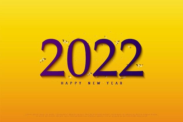 Gelukkig nieuwjaar 2022 op gele achtergrond met gouden lintdecoratie