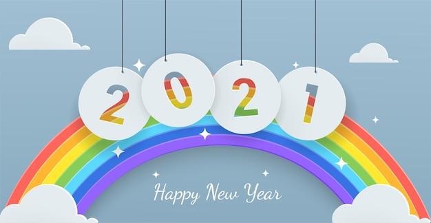 Gelukkig nieuwjaar achtergrond gratis nieuwjaar posterpapier gesneden stijl met regenboog en wolk