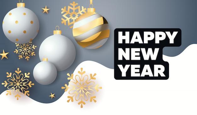 Gelukkig nieuwjaar belettering met kerstballen en sneeuwvlokken