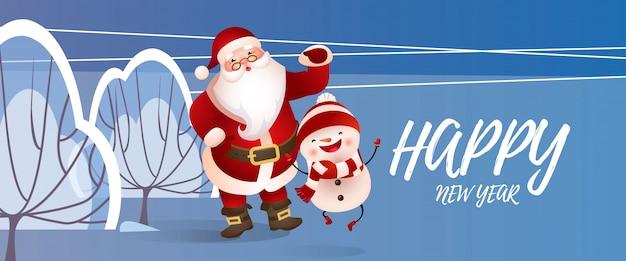 Gelukkig nieuwjaar belettering met kerstman en sneeuwpop