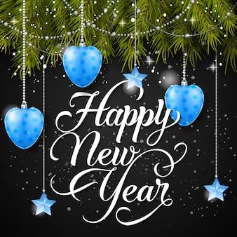 Gelukkig nieuwjaar inscriptie en kerstballen