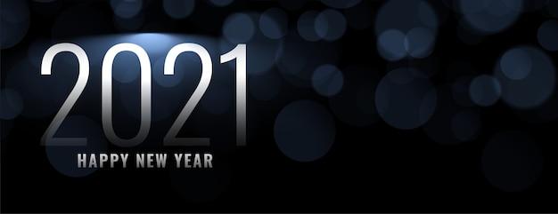 Gelukkig nieuwjaar op bokeh lichteffectachtergrond