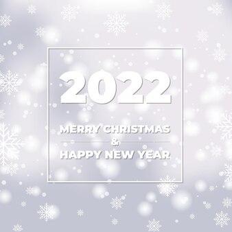 Gelukkig nieuwjaar witte bokeh achtergrond met sneeuwvlokken