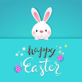 Gelukkig pasen-wenskaart met wit konijn en eieren
