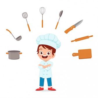 Gelukkig schattig kind jongen ins chef-kok kostuum