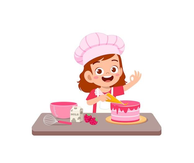 Gelukkig schattig klein kind meisje dragen uniform chef-kok en koken een verjaardagstaart