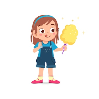 Gelukkig schattig klein kind meisje eet snoep en snoep