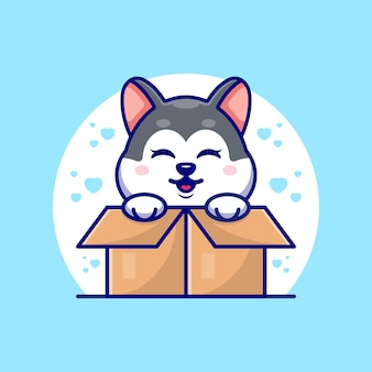 Gelukkig schattige husky in kartonnen doos
