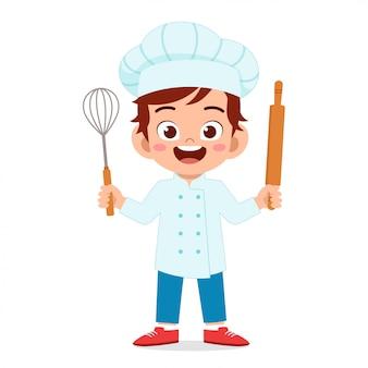 Gelukkig schattige jongen jongen in chef-kok kostuum