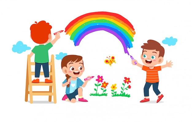 Gelukkig schattige kleine jongen jongen en meisje samen tekenen met verf op de muur